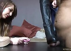 Another transgirl in heels doing a footjob