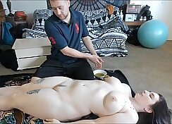 Busty teenager practices oil massage with her sex therapist