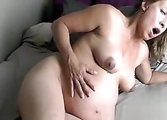 Pregnant Hedges Fingers A Chair While Her Orgasm Is Breached